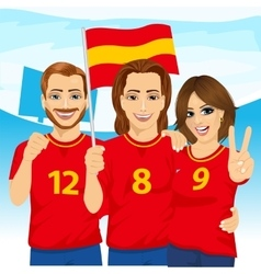 Three excited Spanish soccer fans in stadium vector image vector image
