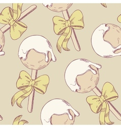 Cake pops with bow seamless pattern vector