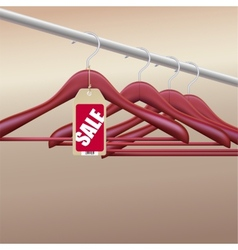 Wooden hangers with sale tag vector