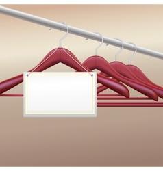 Wooden hangers with label vector image