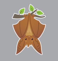 Bat handing upside down on branch vector