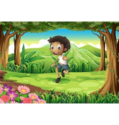 An energetic young boy in the middle of the forest vector image