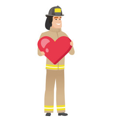 Caucasian firefighter holding a big red heart vector