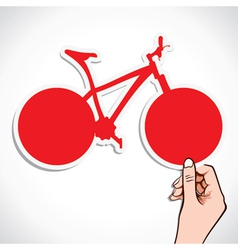 red bicycle sticker in hand vector image