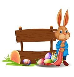 A bunny near a wooden signboard with eggs vector