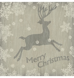 Christmas deer with snowflakes on wood vector