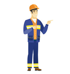 young asian builder pointing to the side vector image vector image