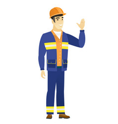 young asian builder waving his hand vector image vector image
