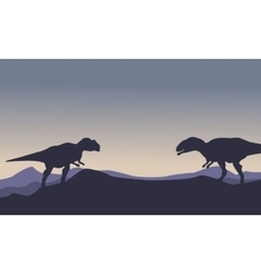 Silhouette of mapusaurus on the hill scenery vector