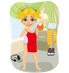 Little girl trying on red dress in her bedroom vector