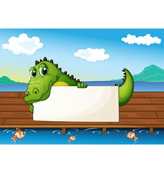 An alligator holding an empty signboard at the vector image