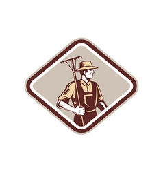 Organic farmer holding rake side woodcut vector