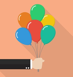 Hand holding colorful balloons vector