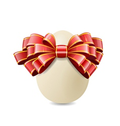 chicken egg and red bow vector image vector image