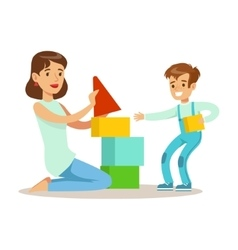Mom playing blocks with her son loving mother vector