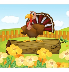A turkey above a trunk inside the fence vector