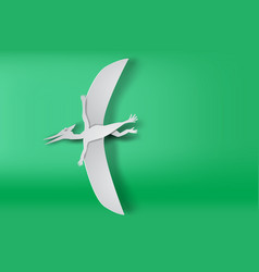 Paper art of pteranodon dinosour on green vector