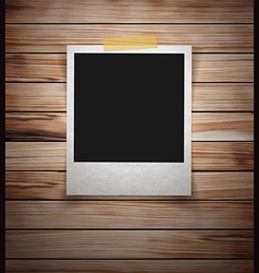 Photo frame stick on vintage wooden texture vector