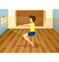 A man exercising inside the studio vector image
