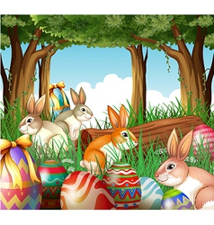 A group of bunnies and easter eggs vector