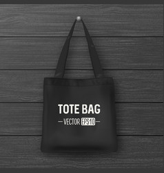 Realistic black empty textile tote bag vector