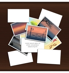 Stack of photos on wood background vector