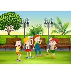 Boy and girl playing monkey in the park vector image vector image