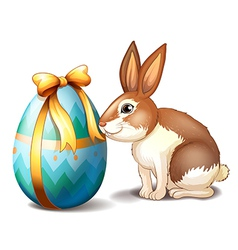 A rabbit and an Easter egg with a ribbon vector image