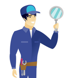 Young asian mechanic holding hand mirror vector