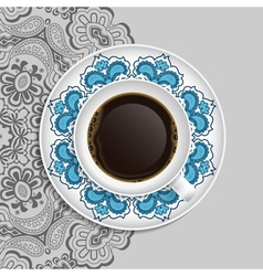 Cup of coffee and decorative ornament on a saucer vector image