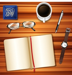 Notebook on table with other accessories vector image