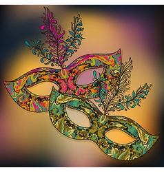 Two floral venetian carnival masks with f vector