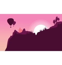 Silhouette of hot air balloon flying at sunrise vector image