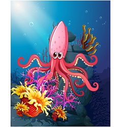 A big squid under the sea with the corals vector image