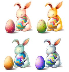 Four rabbits with easter eggs vector