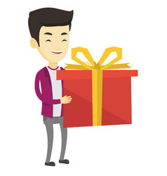 Joyful asian man holding box with gift vector