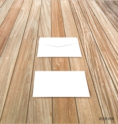 White envelope on wood background vector