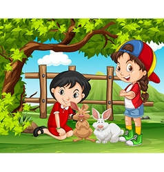 Girls playing with rabbits in the farm vector