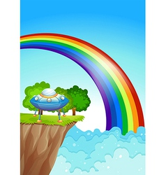 A saucer at the cliff and a rainbow in the sky vector image