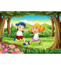 A forest with a young boy and girl vector image vector image