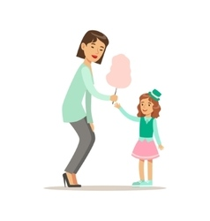 Mom giving cotton candy to daughter loving mother vector