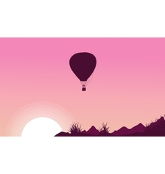 Silhouette of hot air balloon on pink backgrounds vector image