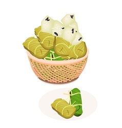 Steamed sticky rice with banana in a brown basket vector