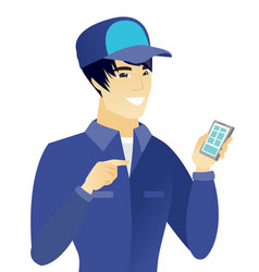 Young asian mechanic holding a mobile phone vector