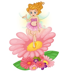 A fairy standing above the flower vector