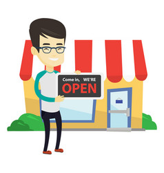Asian shop owner holding open signboard vector