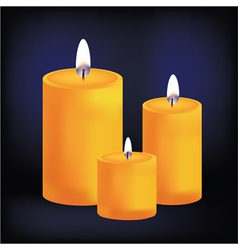 Realistic three yellow candles on dark background vector