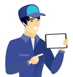 Young asian mechanic holding tablet computer vector