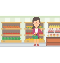 Woman holding supermarket basket vector