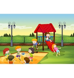 Children playing together in the playground vector